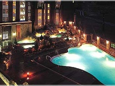 View of heated pool at night.