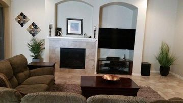 Buckeye house rental - Living Room: 60' LED/3D/Smart TV, Gas Fireplace, Wrap-around Couch with recliner