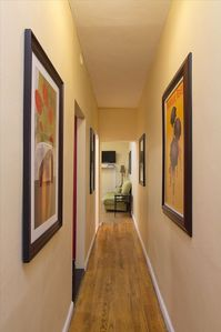 Long Hallway, Entrance has wall of modern art, new renovations.