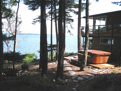 The lower level features a large hot tub and outdoor sauna.