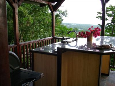 Outdoor kitchen with BBQ, bar, french press coffee maker, coast line ocean view