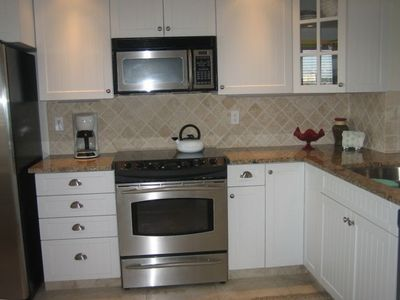 Fully-equipped Gourmet Kitchen with granite countertops and stainless appliances