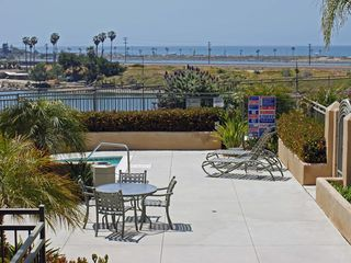Carlsbad condo photo - lower common patio with hot tub right outside our door. Lagoon and ocean beyond