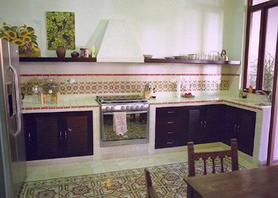 Kitchen with gas stove and refrigerator.