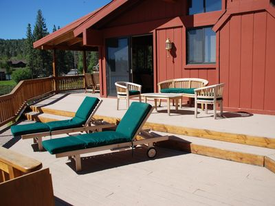 Enjoy sunny days and cool nights on the teak furniture on the deck.