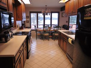 Hillman house photo - An open galley kitchen with plenty of counter space, cabinets and elbow room