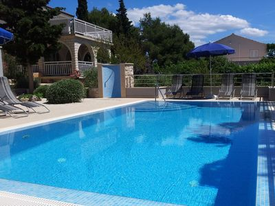 heated swimming pool (30 m²) with outdoor shower