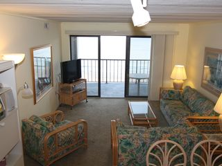 Vacation Homes in Ocean City condo photo - Full Living Room View showing New HD 1080P TV, Cushioned Chairs for 6, Balcony