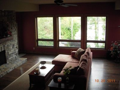 Family room on lower level. Equipped with fireplace, LED TV, and surround sound.