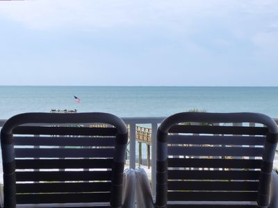 Enjoy a tropical drink on your private balcony overlooking the Gulf of Mexico