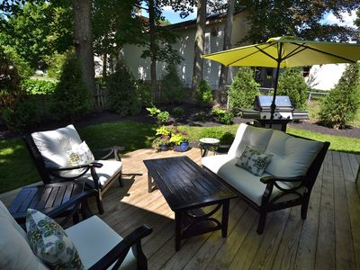 Relax in the comfortable backyard in the village of Skaneateles...Walk to all!
