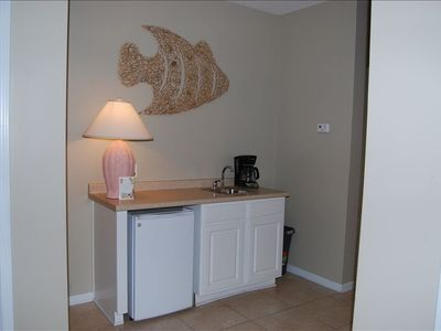 Wet bar with small refrigerator, sink and coffee maker