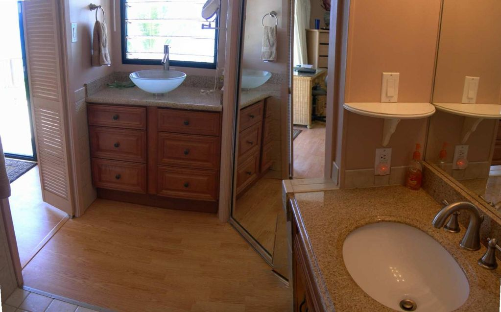 Master bath with his and her sinks and closet.