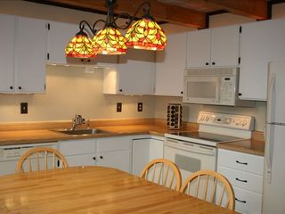 Silverthorne condo photo - Fully equipped clean kitchen with spice rack and water filter.