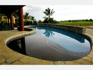 Playa Negra house photo - Pool features tanning ledge and lots of in-pool seating,