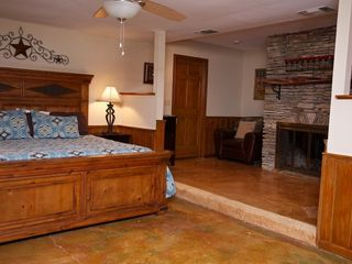 Master bedroom with king bed and private bathroom. - Wimberley house vacation rental photo