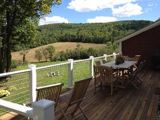 Woodstock farmhouse photo - Deck which seats 10 at table