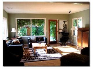 Los Angeles house photo - Living room, from den. Door opens to pool. There is now one more love seat.