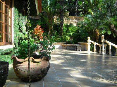 Multipule walkways and patios with Lush gardens