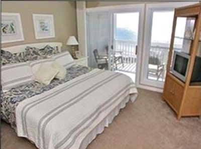 Master Bedroom with spacious side by side closets and private balcony
