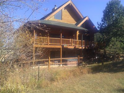 View taken from Fish Creek. Hot tub & porch swing pictured on ground level.