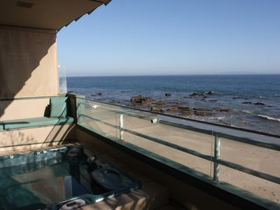 The spa just off the master bedroom with the beach below.
