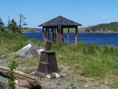 Outdoor fire pit and gazebo looking toward Tors Cove