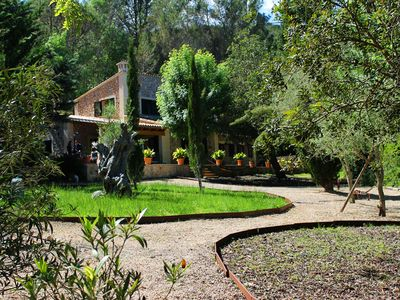 Villa Puigpunynet across open countryside with views on to the Tramuntana mountains