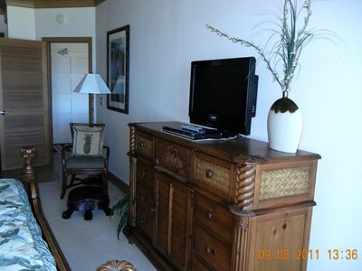 Master bedroom dresser, TV, chair and turtle from sliding glass door to lanai.