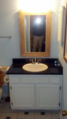 Folly Field condo photo - Master bath with new lights, mirror, granite countertop, sink and faucets.