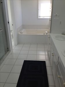 Master bath with full shower,double sink, jacuzzi tub, seperate lavatory room.