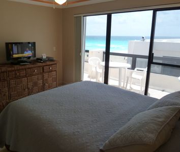 Villa 324: Master bedroom with slightly blocked view, with balcony.