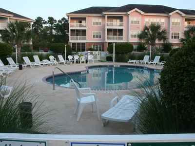 Myrtlewood Villas condo rental - Pool deck in backyard