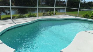 Rotonda West house photo - Solar Heated Pool with Canal View