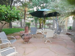 Phoenix house photo - Shady backyard with red flagstone, chiminea and view of 'the village green'.