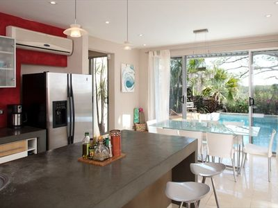 Kitchen and dining area with view of the pool