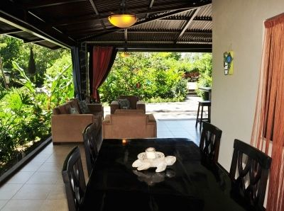 The outdoor dining area & living area.