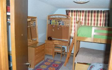 Upstairs bedroom with a twin bed and bunkbed