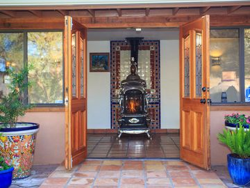 Tubac estate rental - 1915 parlor stove from a Colorado hotel greets you upon arrival.