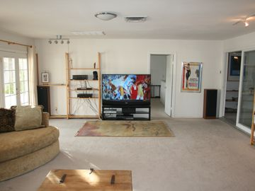 Great Room with 65' HDTV, Stereo surround w/ Ipod docking.