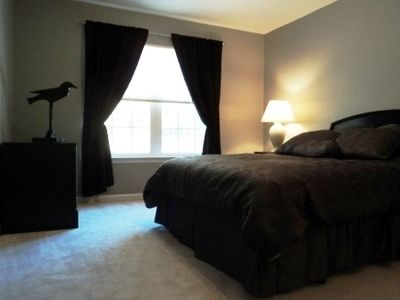 Grey Bedroom has Queen bed, black-out curtains for daytime sleepers.