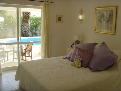 Double Bedroom with access to Pool and Garden