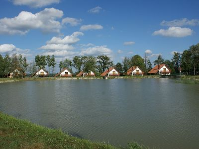 Comfortable cottage at pond. Privat garden, terrace and fireplace. Boat for free use