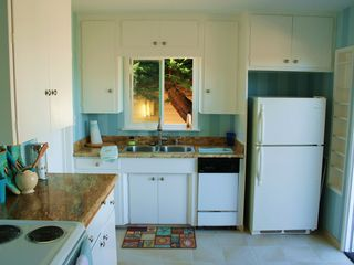 Pacific Grove house photo - Cheery kitchen with new granite, new tile, new stove, and freshly painted