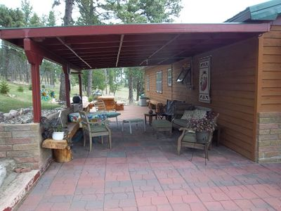 Cover patio with comfortable seating to watch the local deer & wild turkeys!