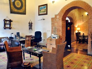 Santo Domingo hotel photo - 16 th century historical building , main lobby , high ceiling, thick walls, arch