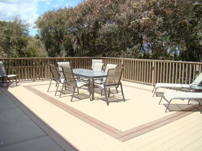 Back deck with views of eucalyptus trees and Pajaro Valley