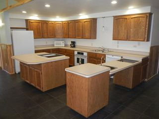 Tiller house photo - Kitchen with handicap stove and sink area