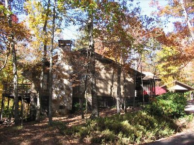Side view of house in Fall with leaves in full color.