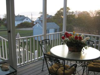 Moody Beach house photo - Screened-In Deck - Soft Lighting for Dining in the Evening